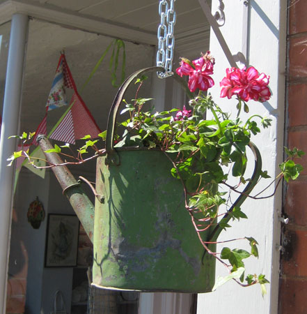 Hanging basket from a watering can