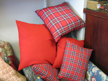 Cushions in tartan and red fabrics